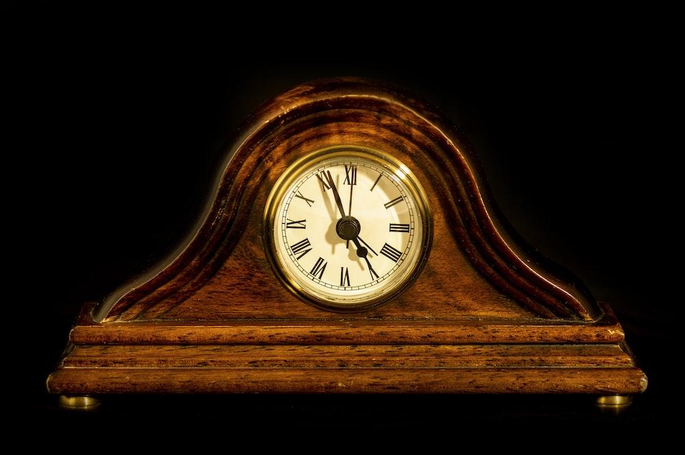 brown wooden framed mantle clock