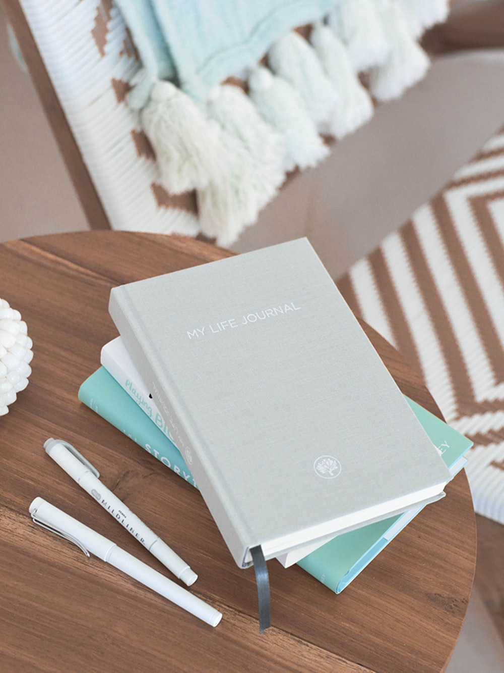 grey labeled book besidepens