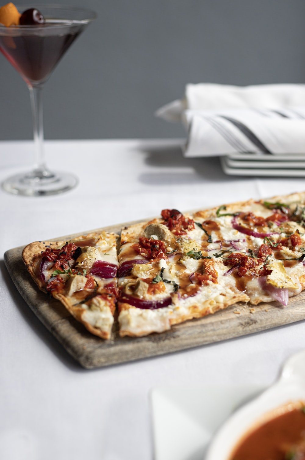 baked pizza on brown wooden platter