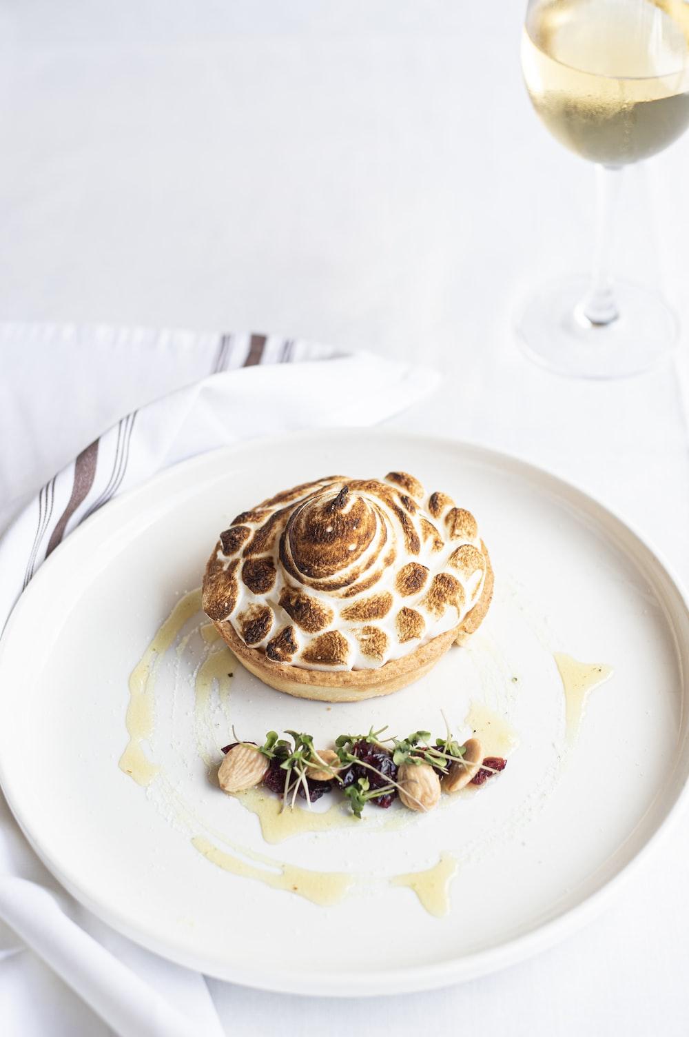 brown pie on round white plate