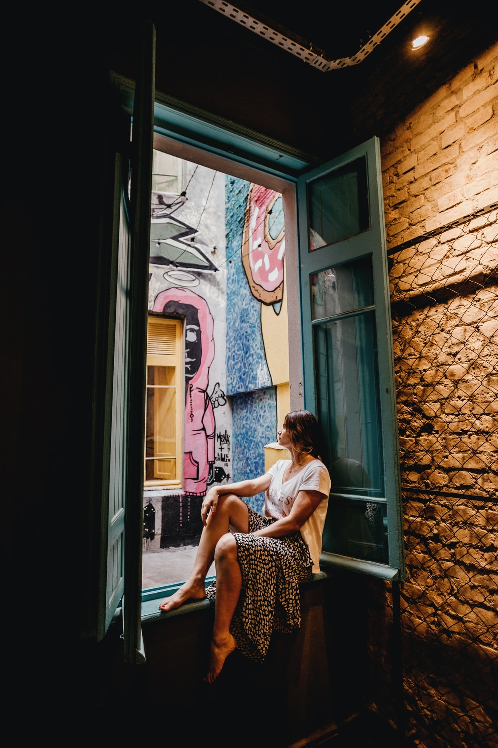 woman sitting by the doorway