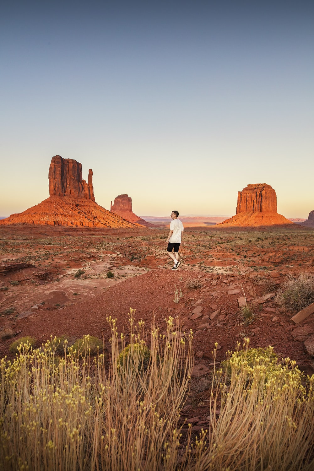 man walking near Monument Valley during daytime