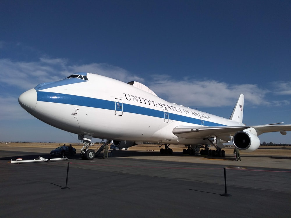 white and blue airliner
