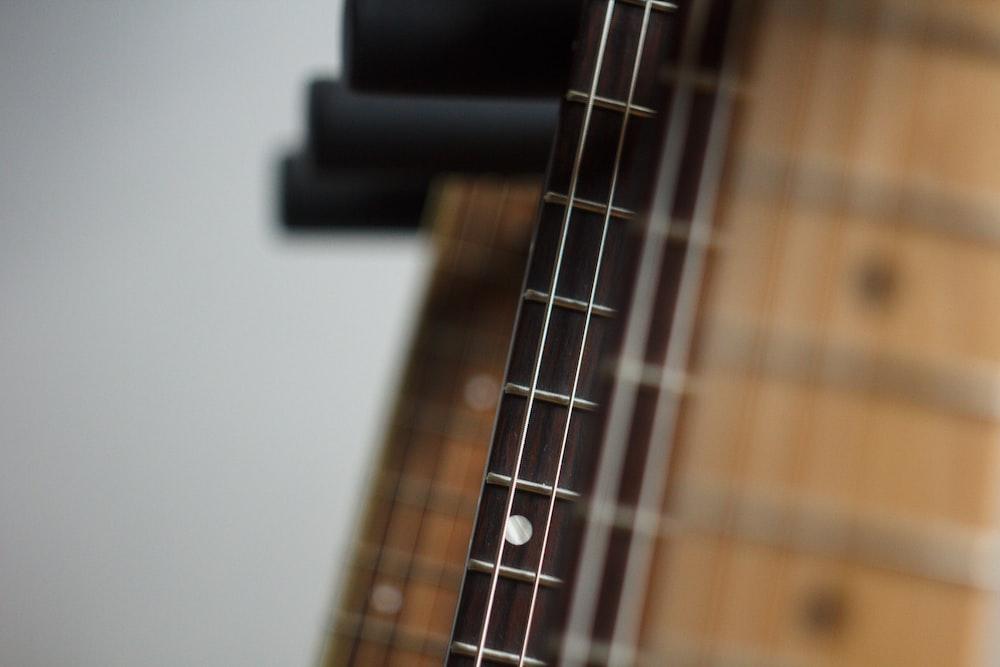 brown and black guitars