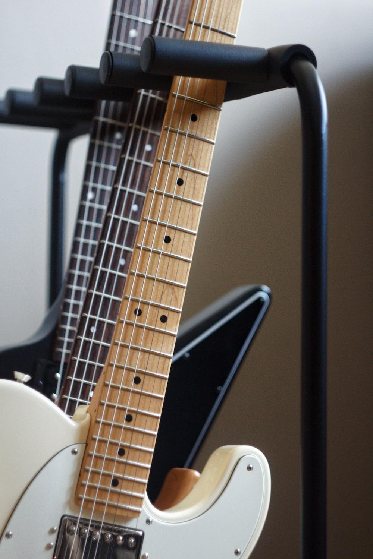 several electric guitars
