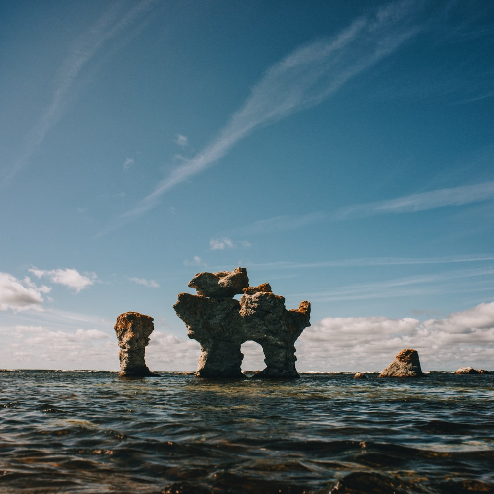 rock on body of water photo