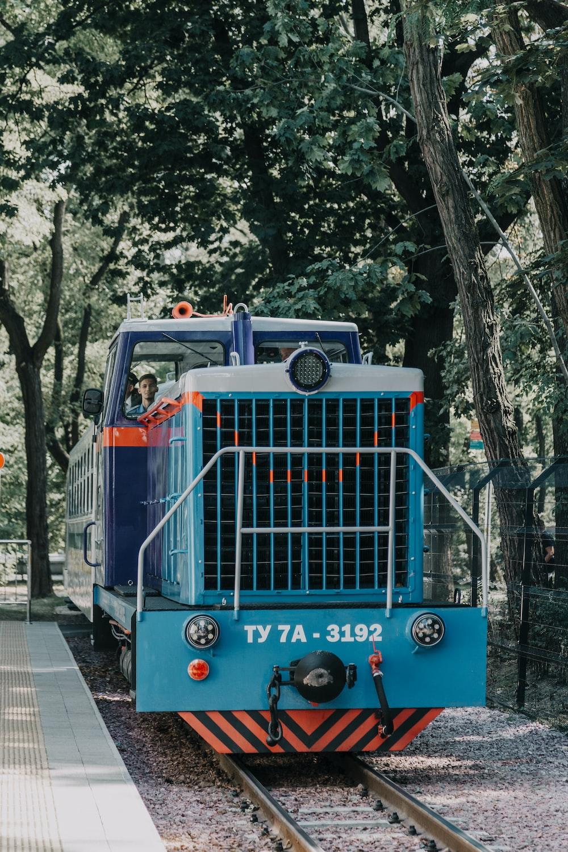 photo of blue charcoal train