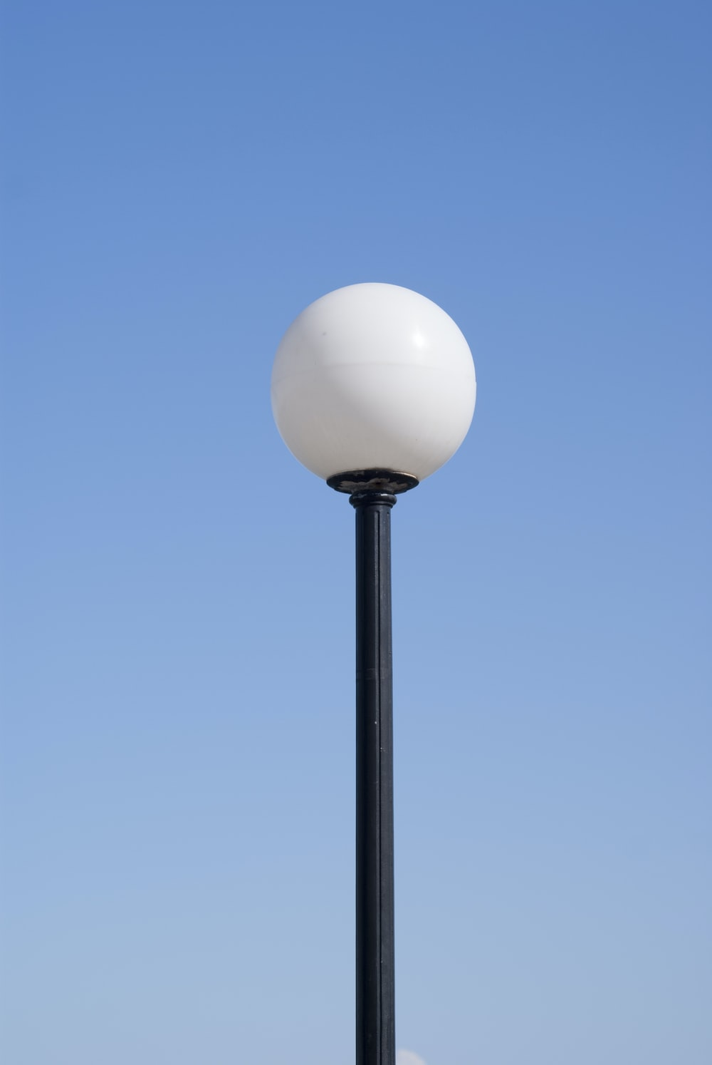 photo of white and black LED post lamp