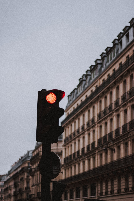 red traffic light beside building