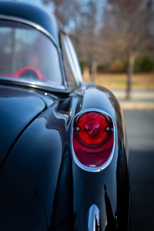 classic black car parked on concrete floor