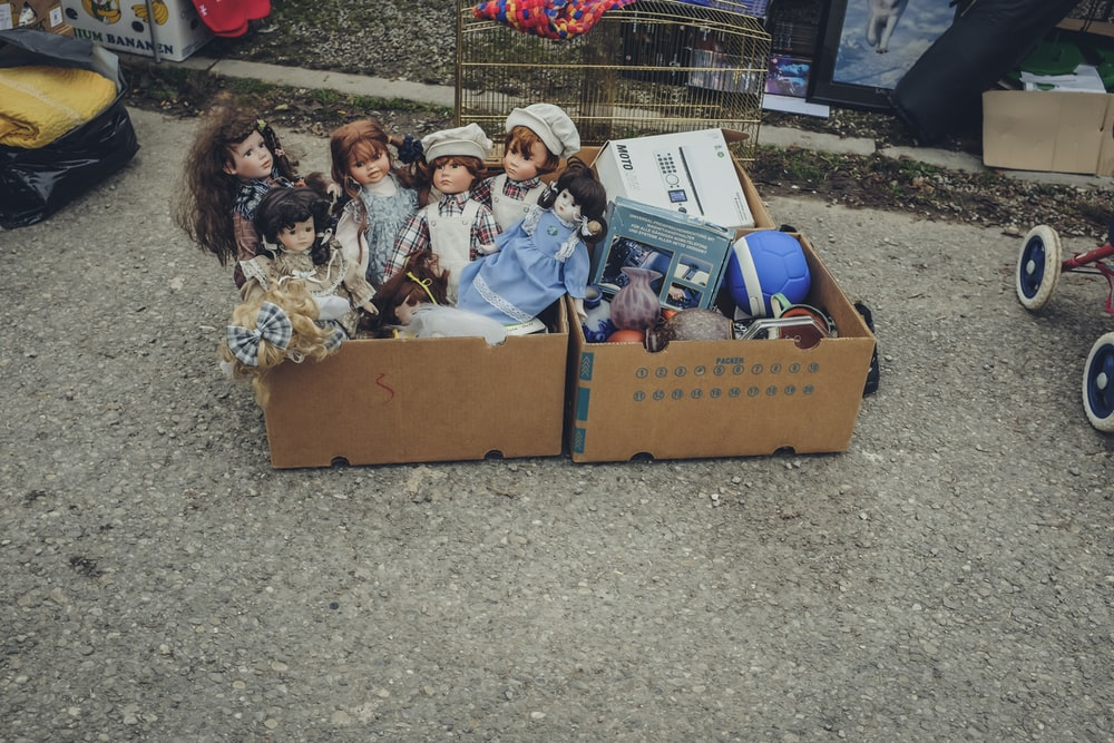 several dolls on cardboard box
