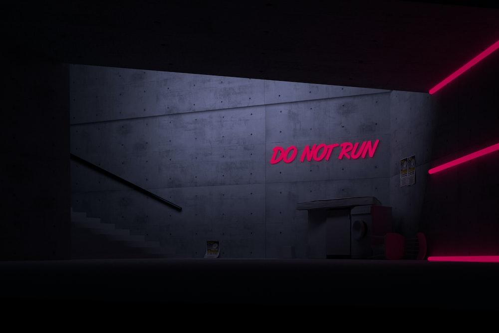 Do Not Run text on gray wall