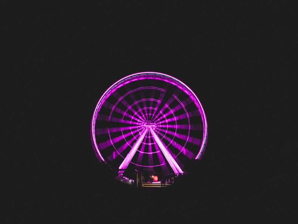 Ferris wheel with purple lights during nighttime