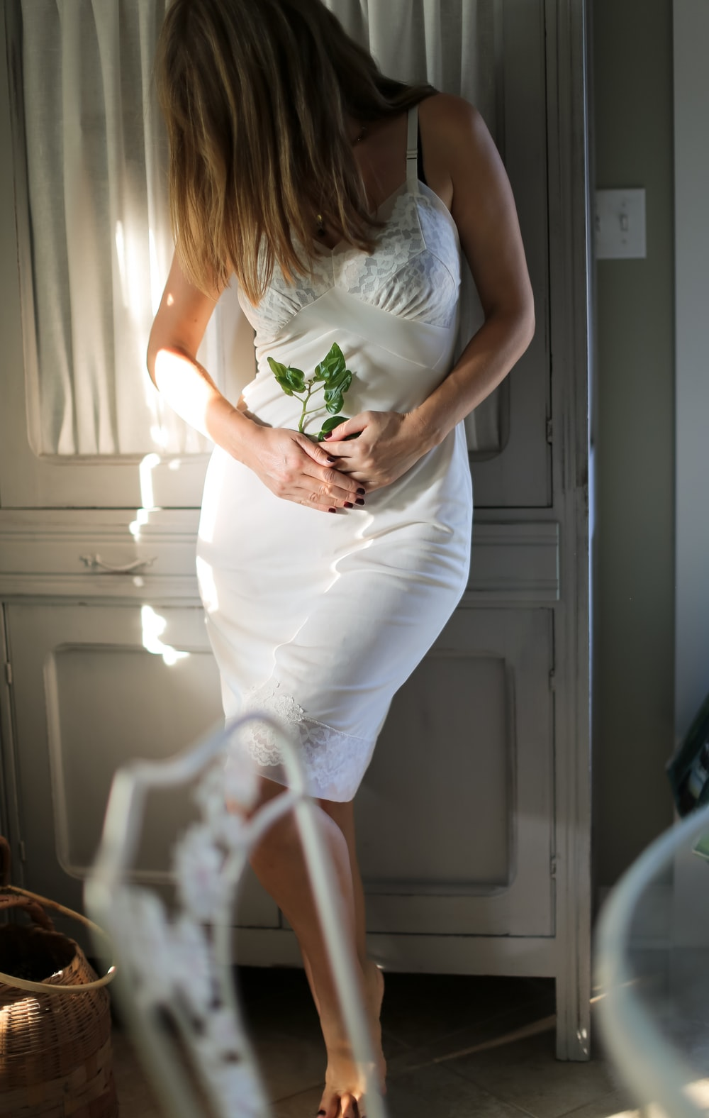 woman leaning on wardrobe