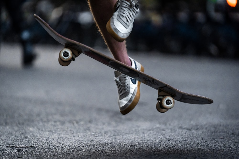 time-lapse photography of man doing skateboard trick