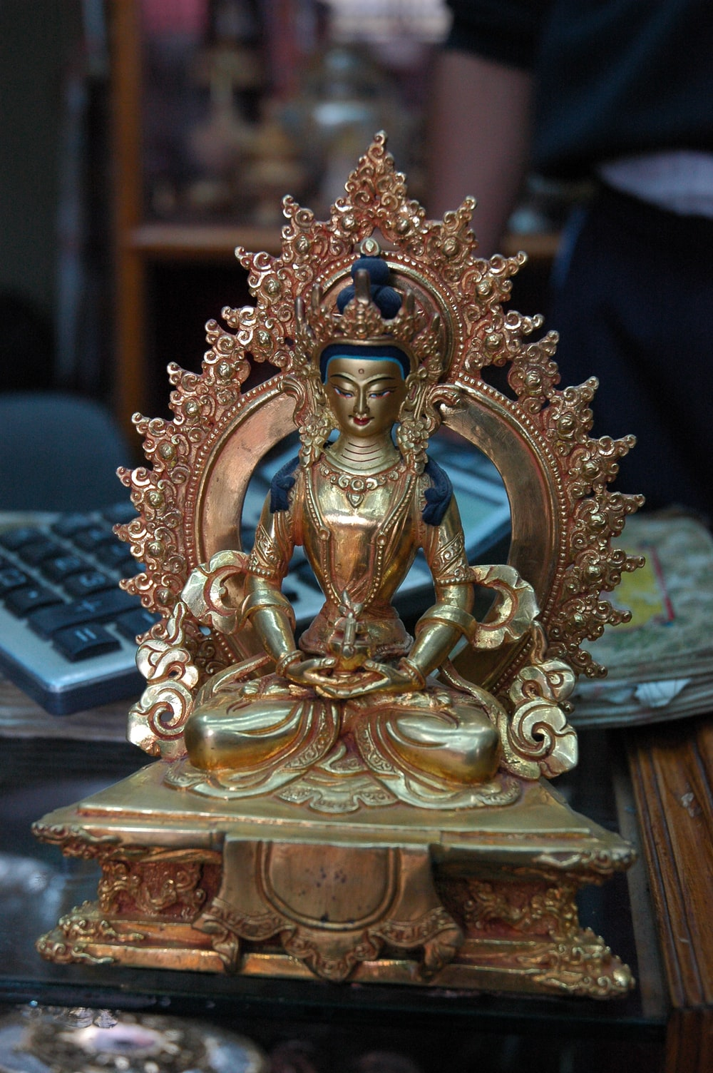 gold-colored figurine