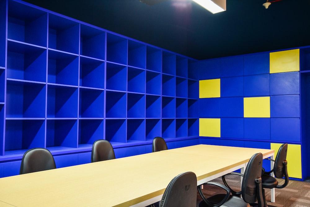 blue wooden shelf near table