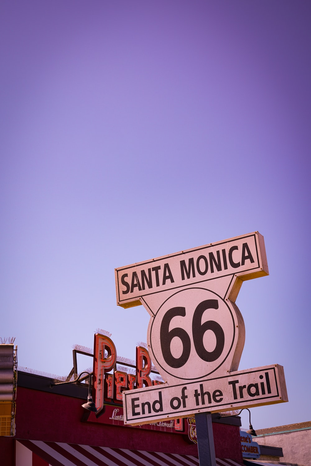Santa Monica 66 End of the Trail signage under blue sky during daytime