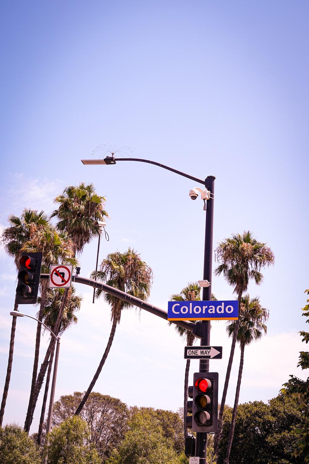 blue Colorado signboard under traffic light
