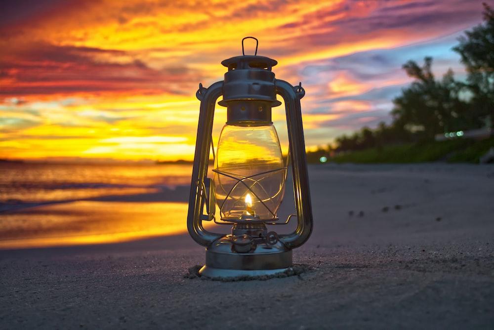 black outdoor lantern on beach