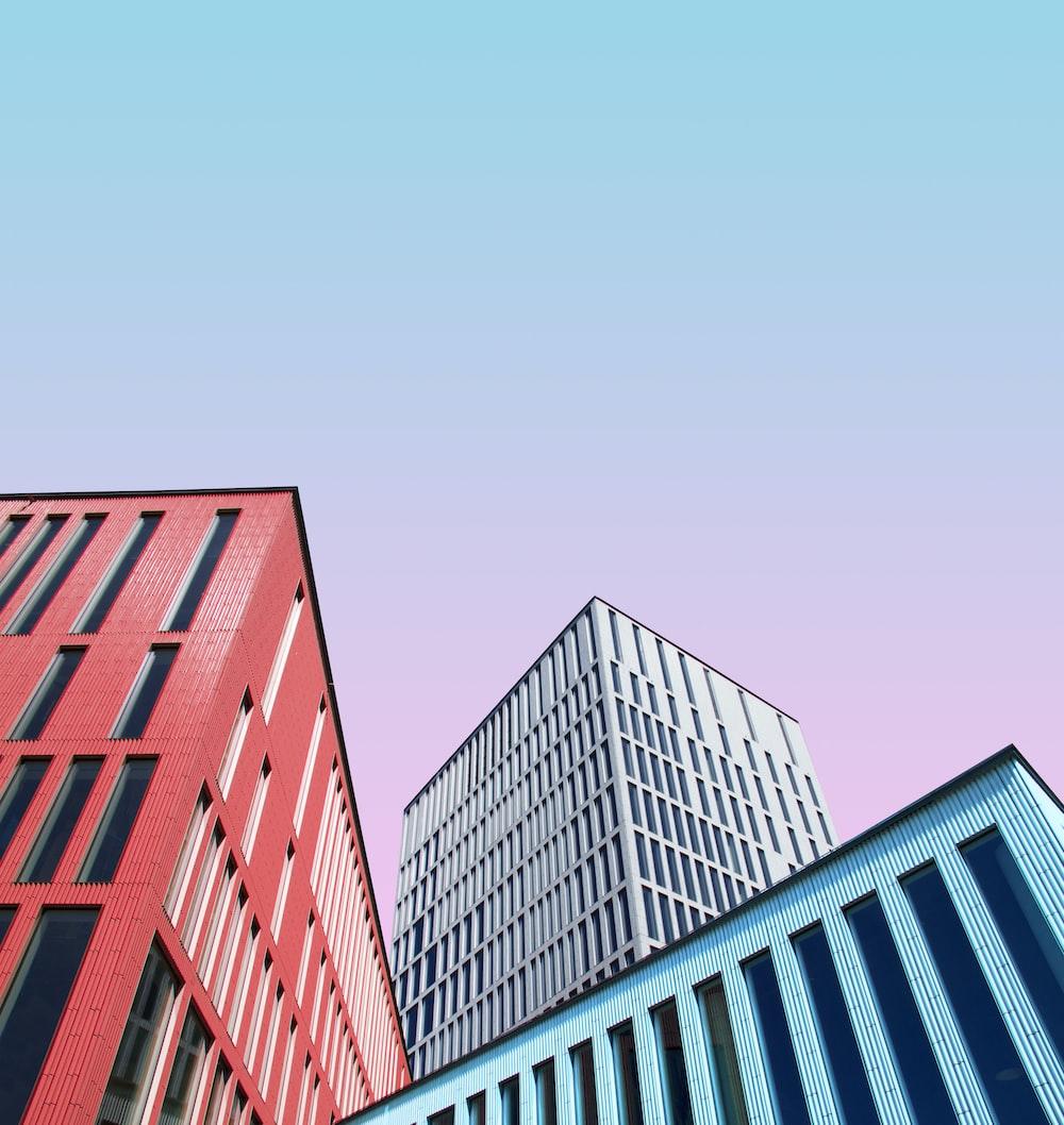 three multicolored buildings