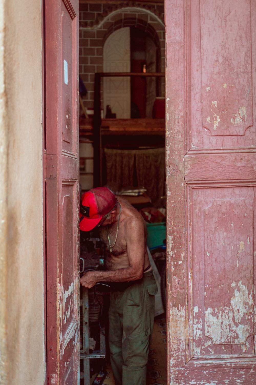 man standing near opened door