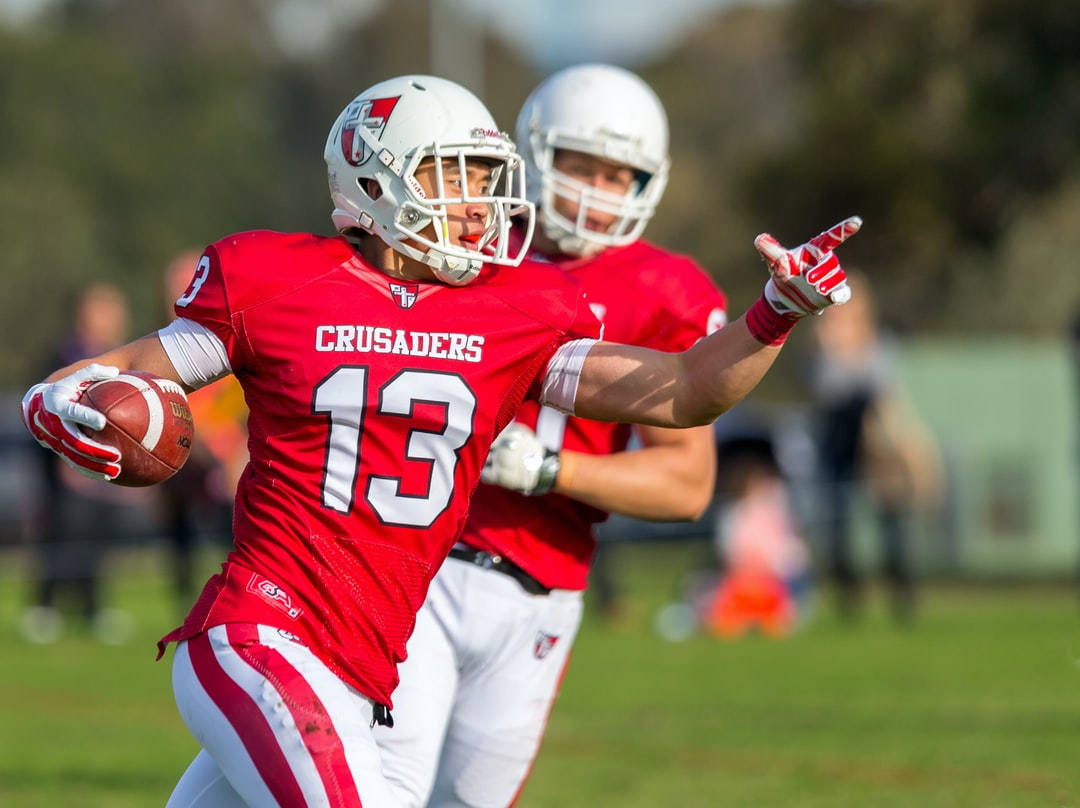 Gridiron Victoria: Aristotle Hua from the Western Crusaders after a touchdown
