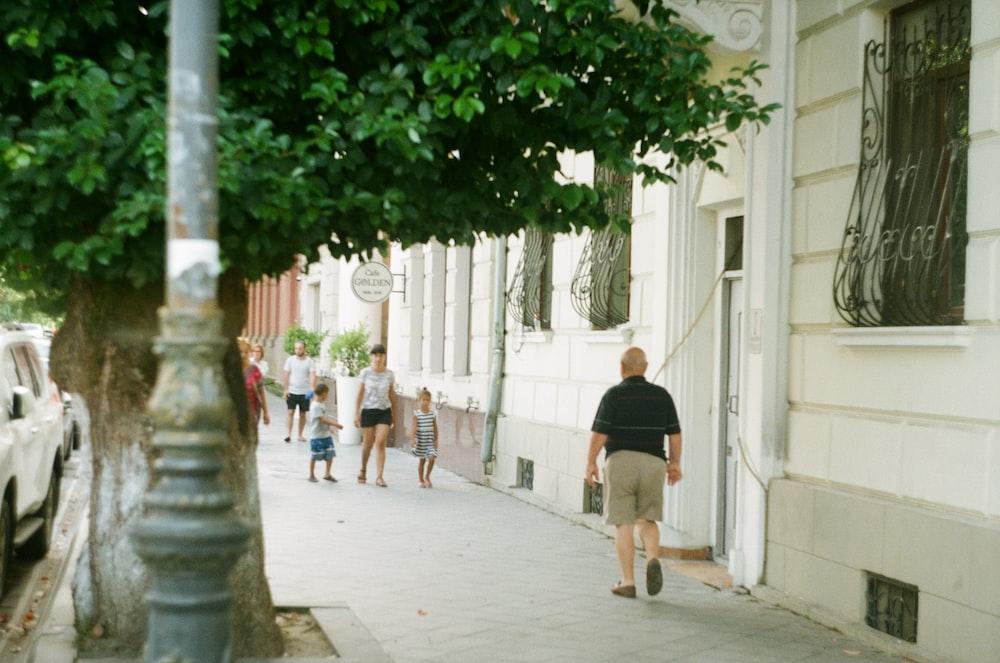 man walking on sidewalk
