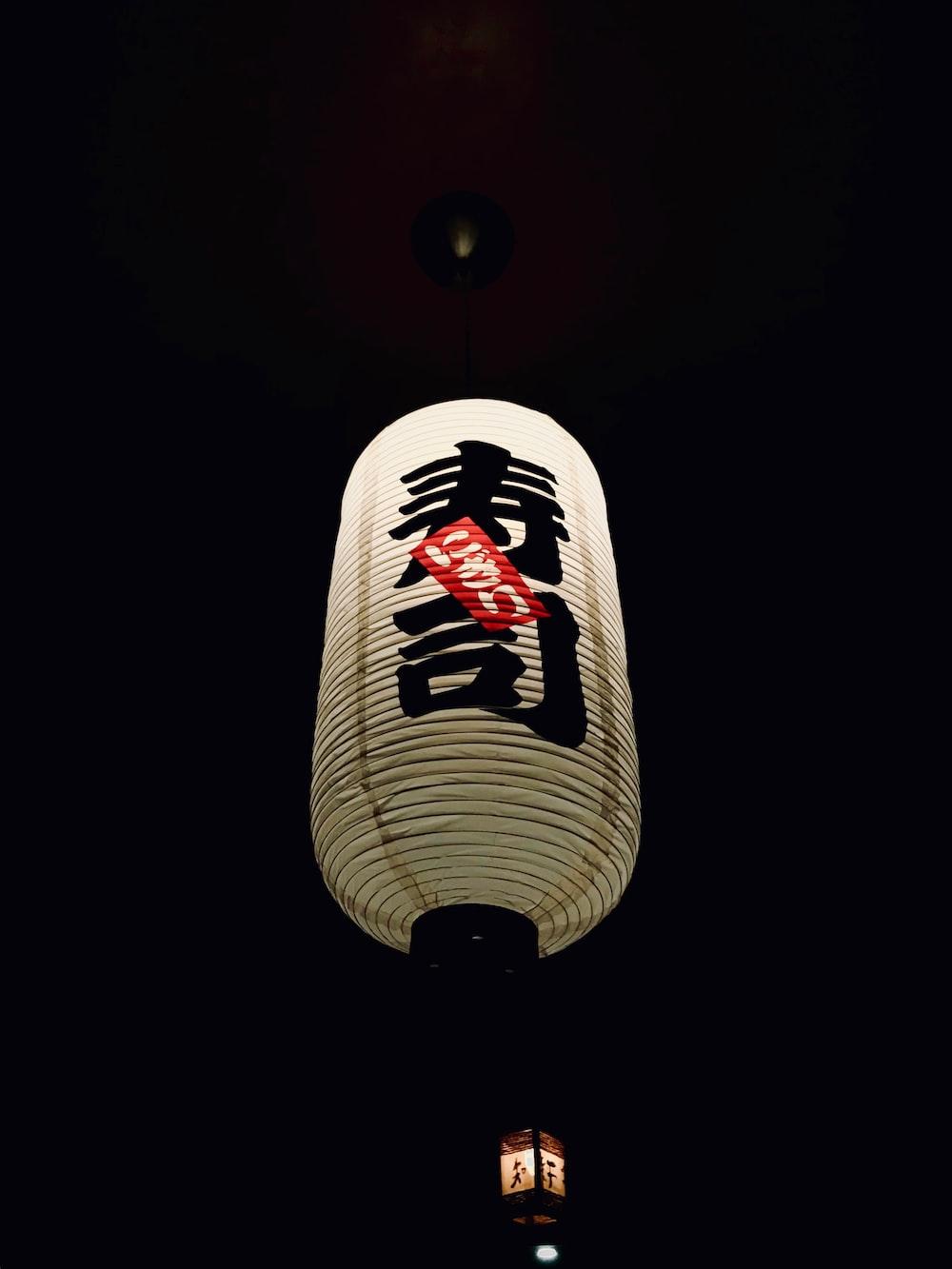 white and black lantern lamp