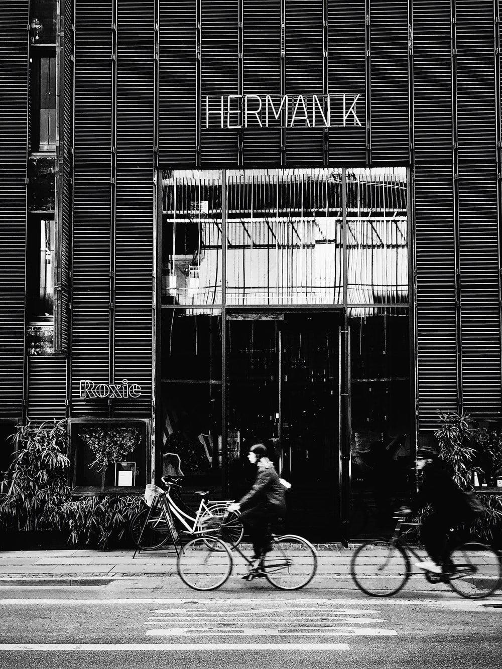 grayscale photography of Herman K shop front