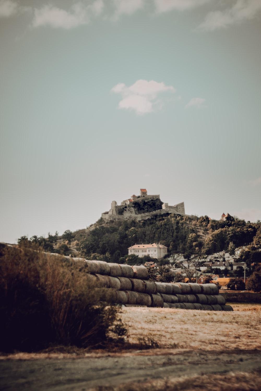 stack hay stack during daytime