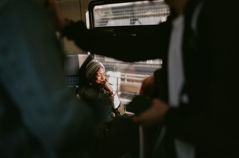 woman wearing grey knit hat