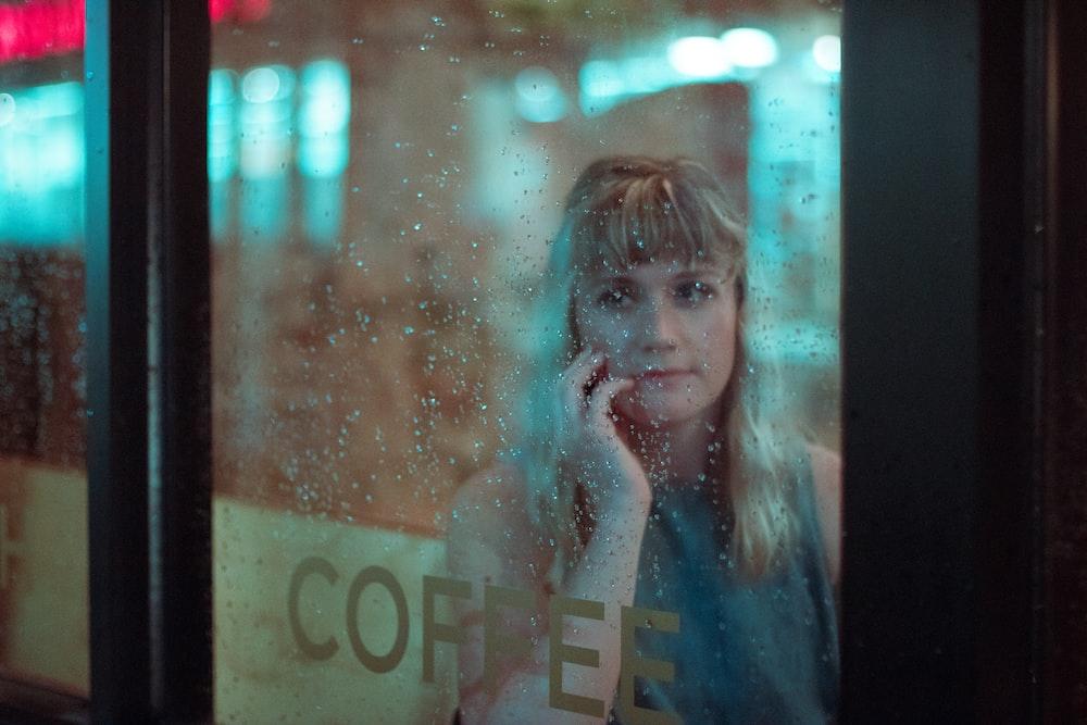woman beside glass window