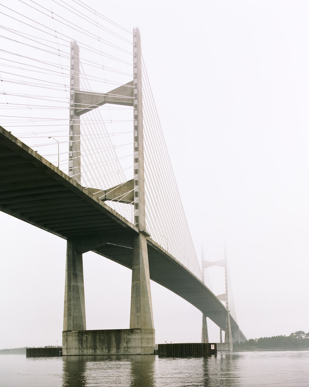 self-anchored suspension bridge during daytime
