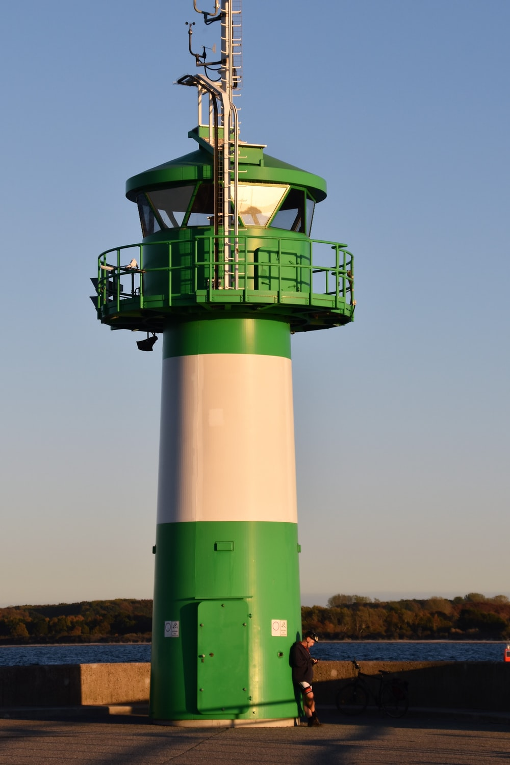 green and white concrete lighthouse