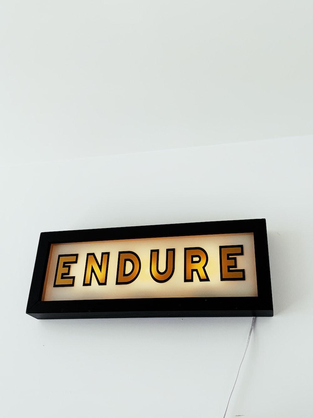 yellow Endure neon signage