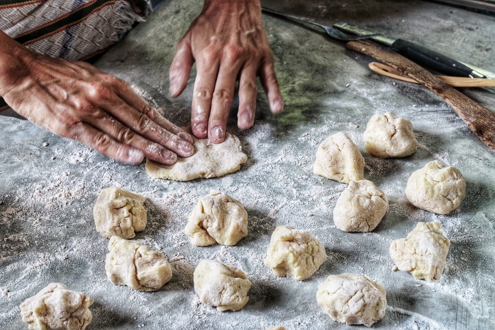 person molding flour