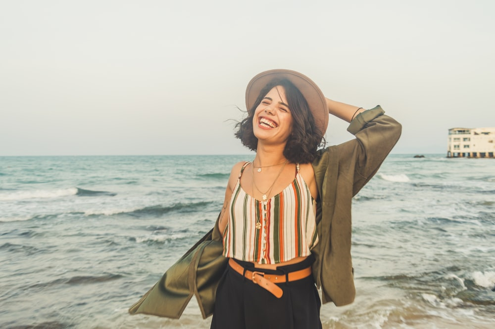 smiling woman standing on seashore