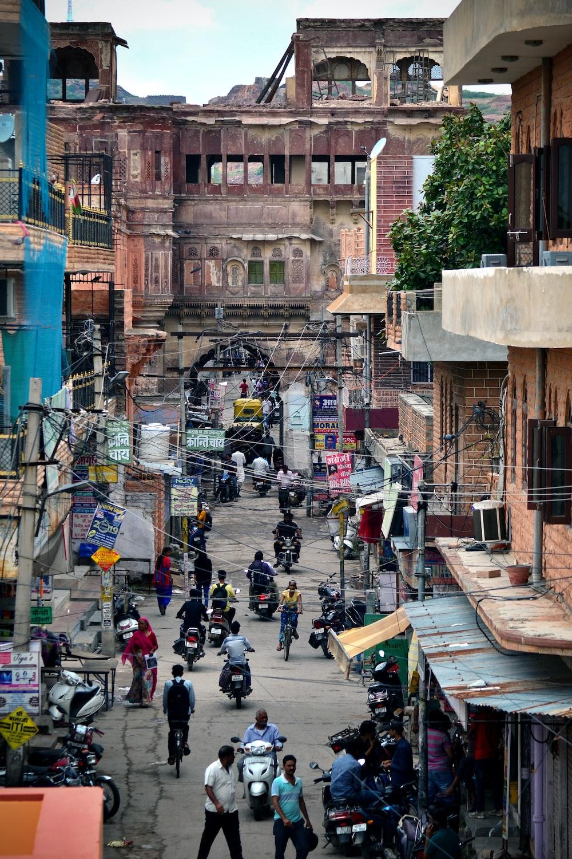 people on street between buildings