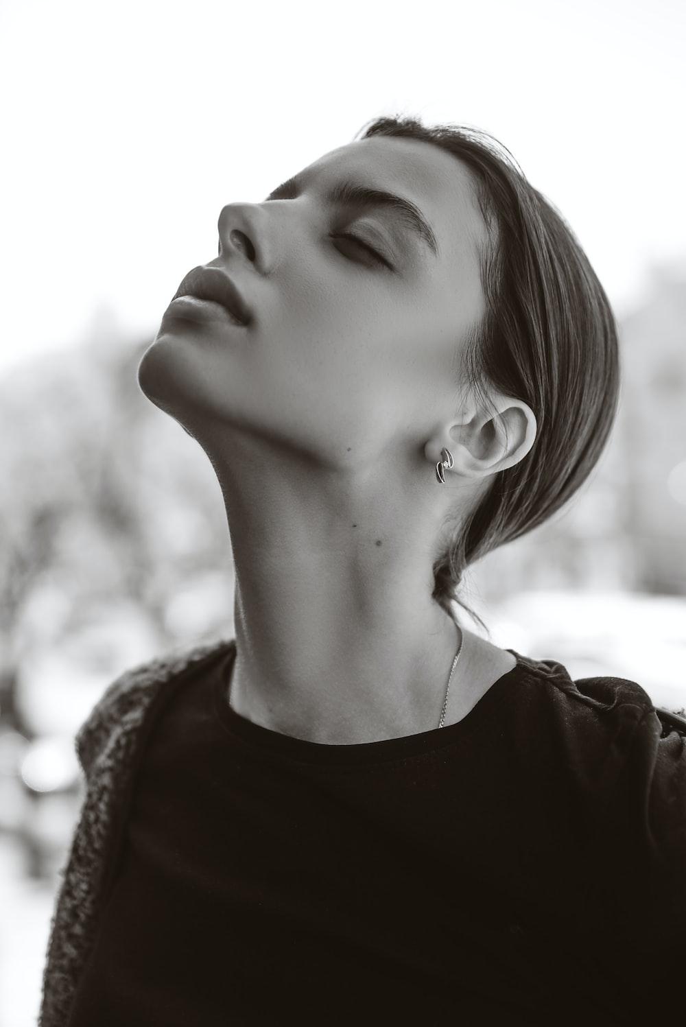 woman wears black crew-neck t-shirt