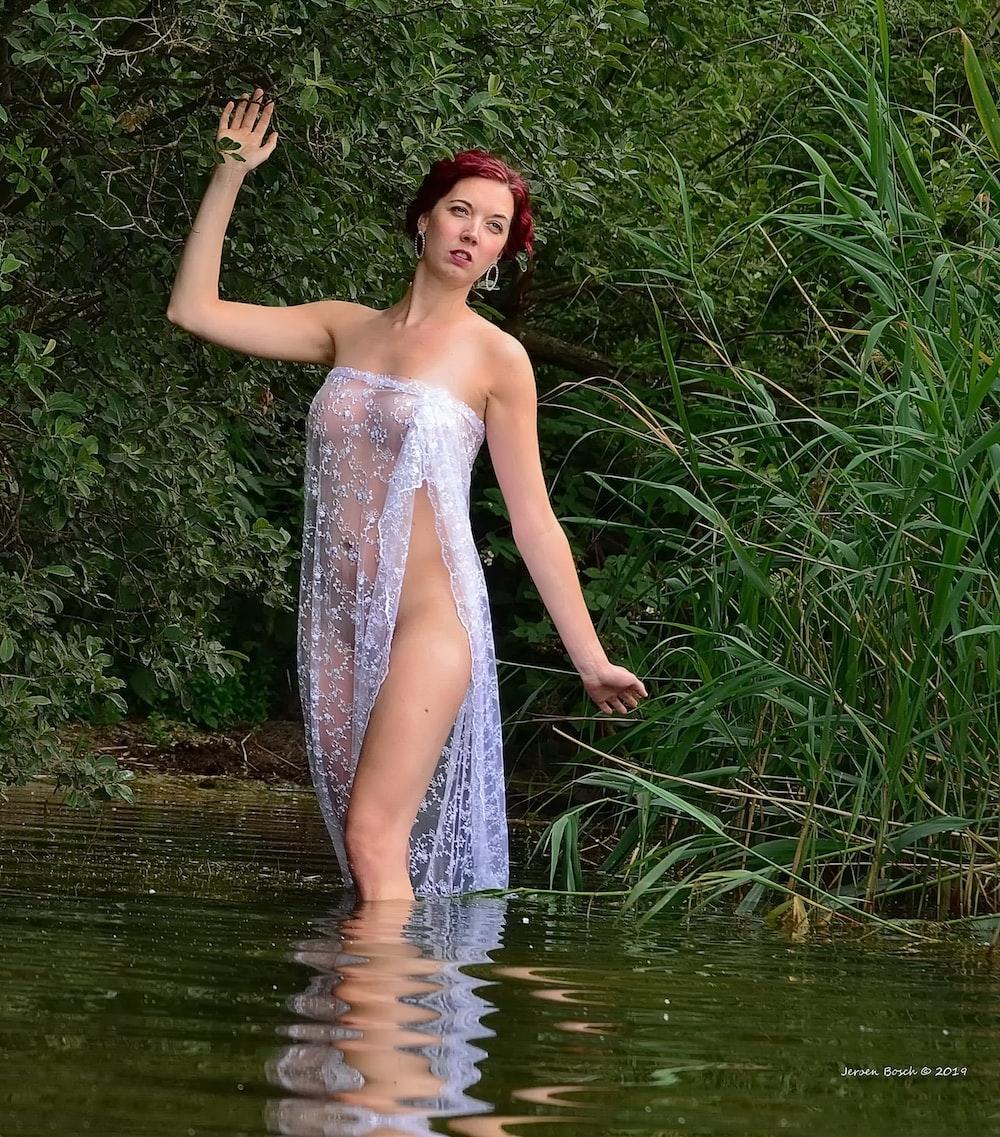 woman wears white side slit dress