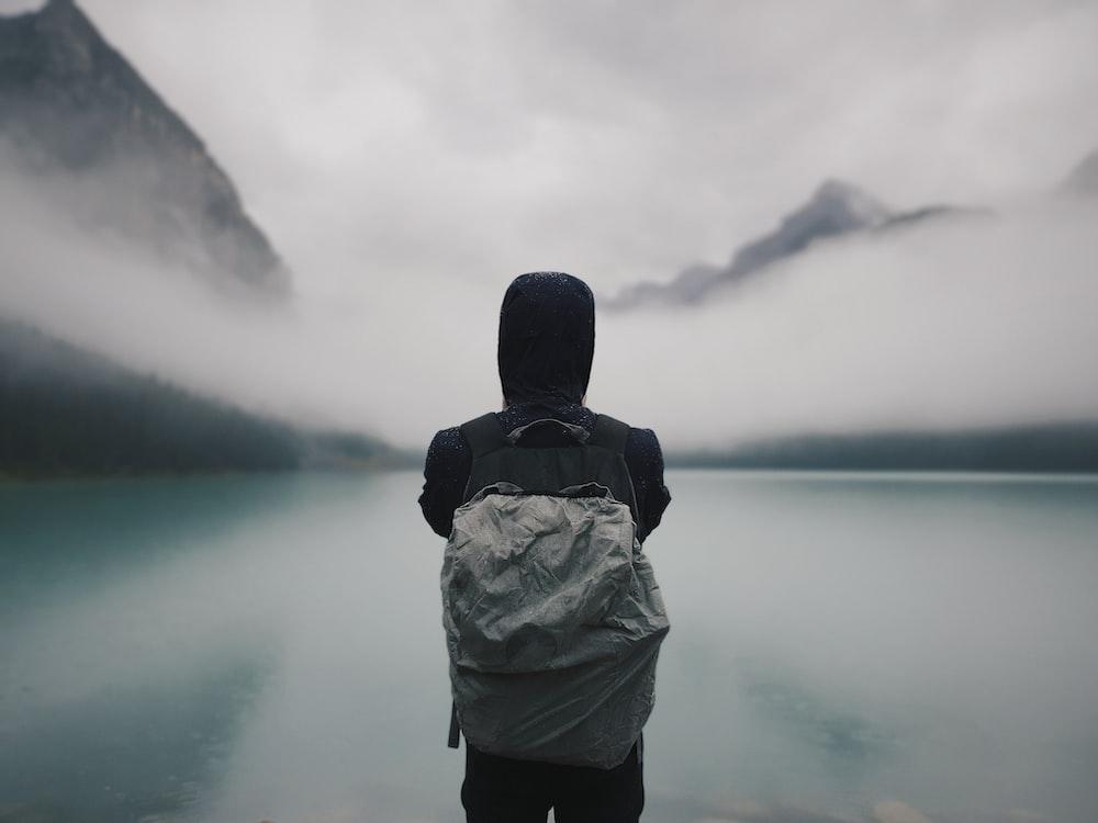 person looking at lake