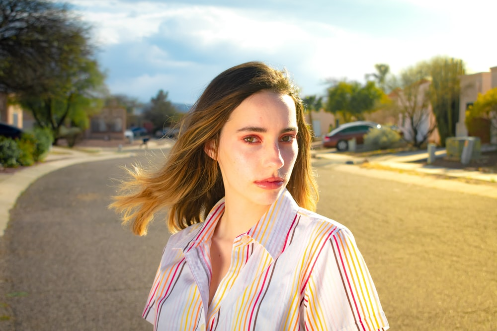 woman wearing white and pink striped collared blouse