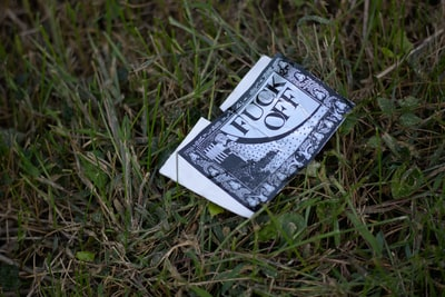 Card discarded on a front lawn.