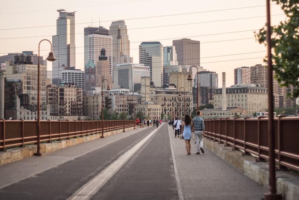 people walking on sidwalk