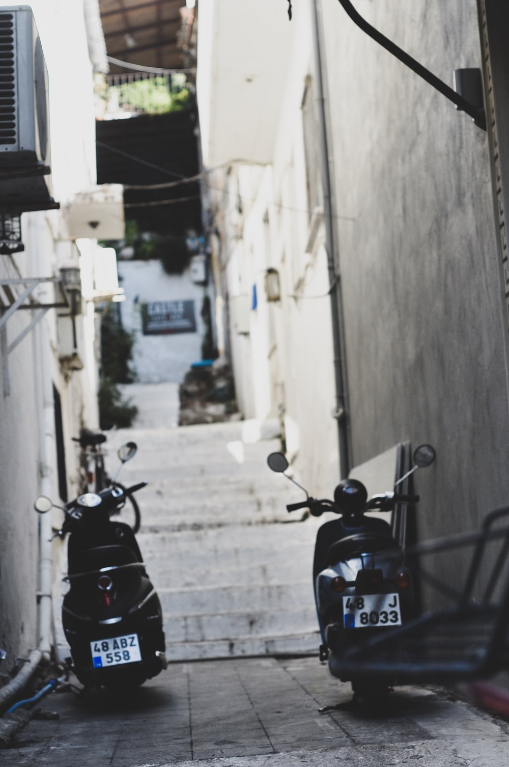 two black motor scooter