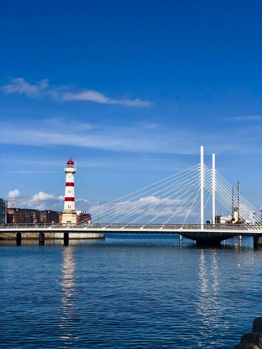 lighthouse beside bridge