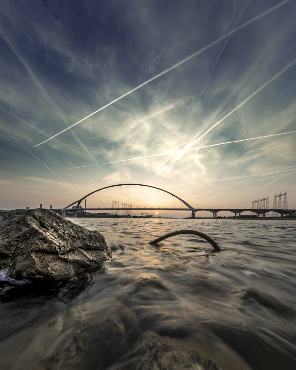timelapse photography of rock and bridge