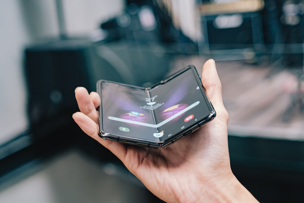 person holds foldable smartphone