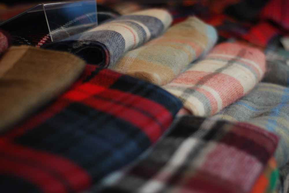 shallow focus photography of assorted-color textiles